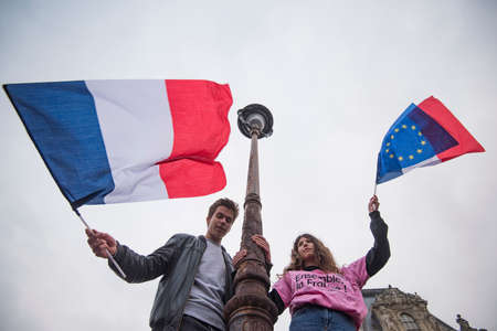 emmanuel: Paris, France - May 7, 2017: People waving french flags in Paris after presidential elections.