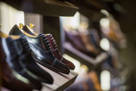 Men shoes in a luxury store in Paris. Stock Photo