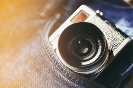Vintage camera in a pocket. Stock Photo