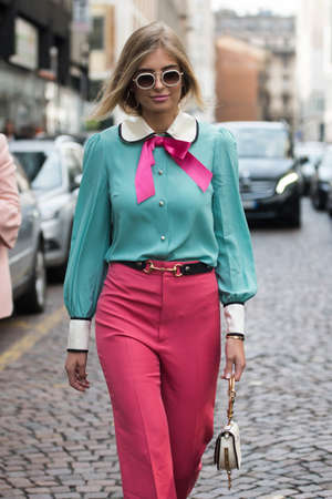 Milan, Italy - September 22, 2017: Girl in a fashionable outfit posing outside the Armani Show during Milano Fashion Show SS2018. Editorial