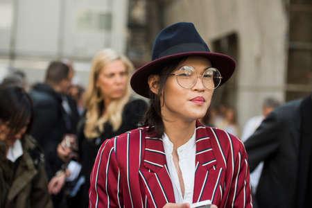 Milan, Italy - September 23, 2017: Fashionable girl posing during Milan Fashion Week - street style fashion concept.