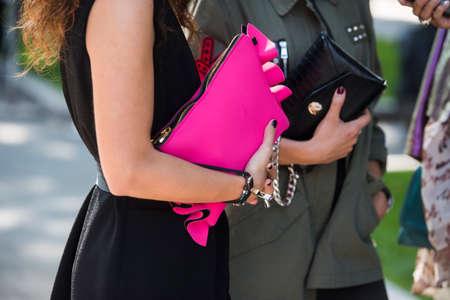 Milan, Italy - September 22, 2017: Fancy girls with luxury purses during Milan Fashion Week. Editorial
