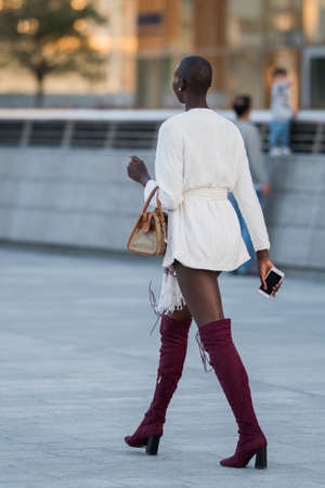 Milan, Italy - September 21, 2017: Fashion model walking on the street during Milan Fashion Week . Sajtókép