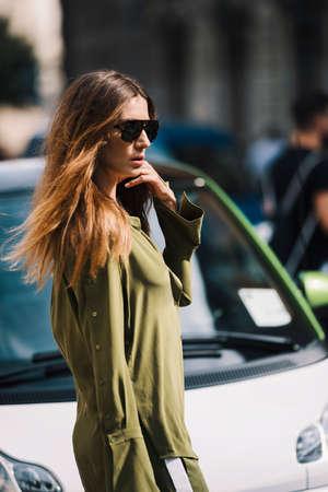 Milan, Italy- September 23, 2017: Fashion girl posing during Milan Fashion Week - street style concept. Sajtókép
