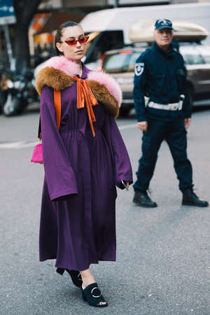 Milan, Italy- September 22, 2017: Fashion girl posing during Milan Fashion Week - street style concept. Editorial