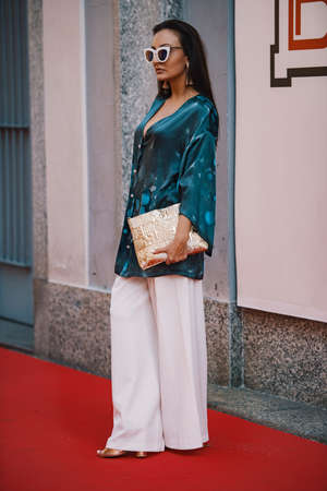 Milan ,Italy- September 24, 2017: Fashion girl posing during Milan Fashion Week - street style concept.