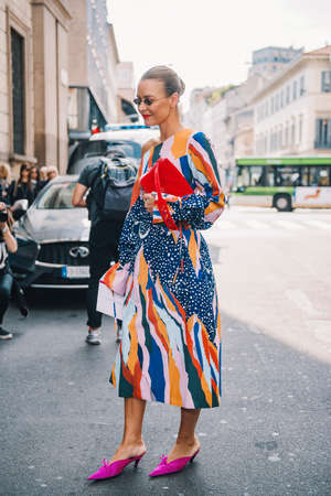 Milan, Italy- September 23, 2017: Fashion girl posing during Milan Fashion Week - street style concept. 에디토리얼