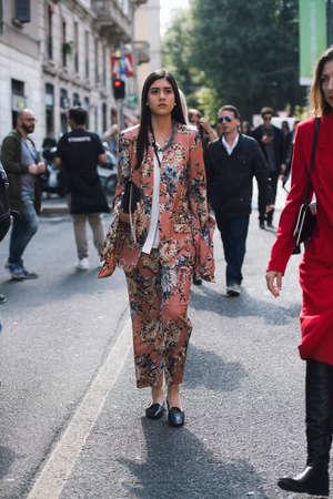 Milan, Italy - September 24, 2017: Fashion girl posing on the street during Milan Fashion Week.