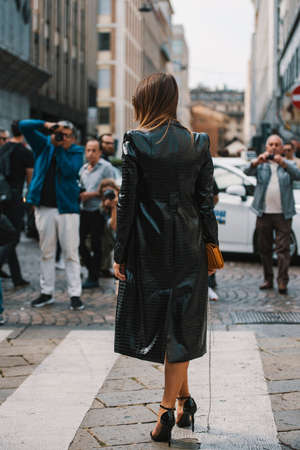 Milan, Italy - September 23, 2017: Fashion girl posing on the street during Milan Fashion Week.