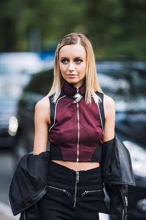 Milan, Italy - September 22, 2017: Fashion girl posing on the street during Milan Fashion Week. Editorial