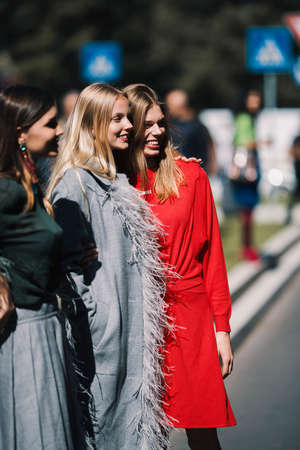Milan, Italy - September 22, 2018: Fashionable girls on the street during Milan Fashion Week. Editorial