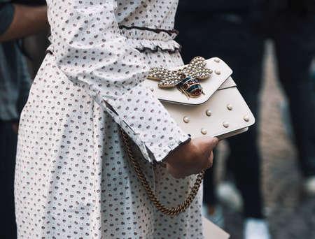 Milan, Italy - September 23, 2018: Woman with a Gucci luxury bag during Milan Fashion Week.