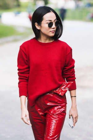 Milan, Italy - September 23, 2017: Asian girl with a stylish outfit posing on the street during Milan Fashion Week.
