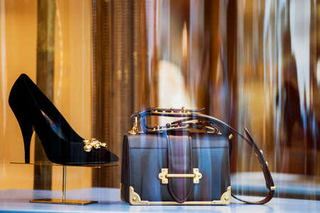 Women luxury purse and shoes in a store in Milan