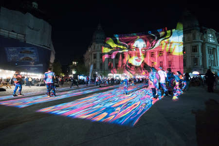 Streets and historic buildings from Bucharest city center are lighten during Spotlight International Light Festival on April 12.