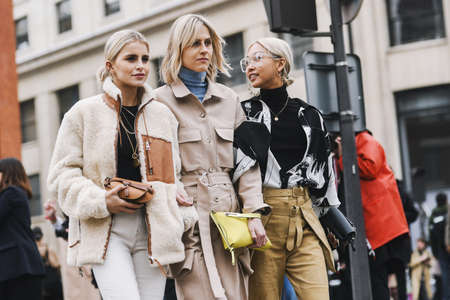 Paris, France - March 01, 2019: Street style outfit - Caroline Daur, Linda Tol, Vanessa Hong after a fashion show during Paris Fashion Week - PFWFW19