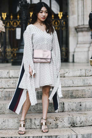 Paris, France - March 04, 2019: Street style outfit -   after a fashion show during Paris Fashion Week - PFWFW19 Publikacyjne