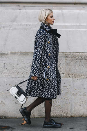 Paris, France - March 02, 2019: Street style outfit -  Caroline Daur after a fashion show during Paris Fashion Week - PFWFW19 Editorial