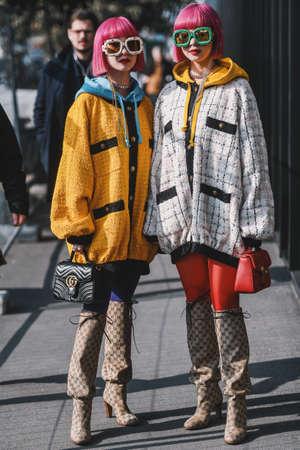 Milan, Italy - February 20, 2019: Street style outfits - Ami Suzuki and Aya Suzuki before a fashion show during Milan Fashion Week - MFWFW19 Editorial