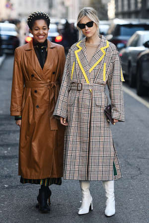Milan, Italy - February 22, 2019: Street style – Influencers Tamu McPherson and Linda Tol after