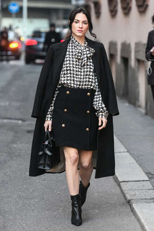 Milan, Italy - February 21, 2019: Street style – Outfit after a fashion show during Milan Fashion Week - MFWFW19
