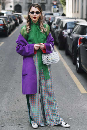 Milan, Italy - February 24, 2019: Street style  outfit after a fashion show during Milan Fashion Week - MFWFW19
