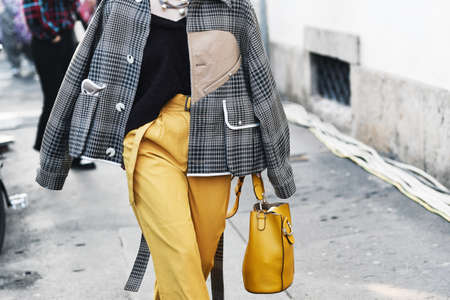 Milan, Italy - February 22, 2019: Street style – Outfit detail after a fashion show during Milan Fashion Week - MFWFW19