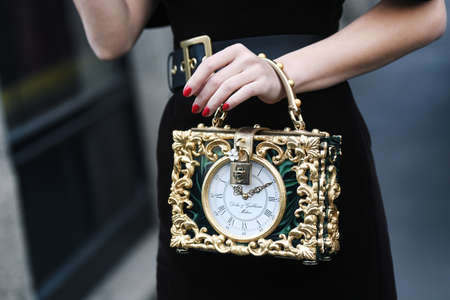Milan, Italy - February 24, 2019: Street style - Details of a Dolce & Gabbana purse worn by influencer Karina Nigay at a fashion show during Milan Fashion Week - MFWFW19