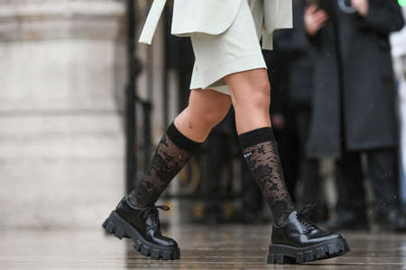 Paris, France – March 2, 2020: Black leather Prada shoes matched with black embroidered Prada socks - streetstylefw20