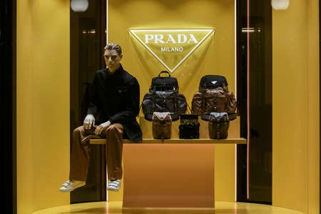 Milan, Italy - January 13, 2020: Prada men's outfit and various backpacks showcase