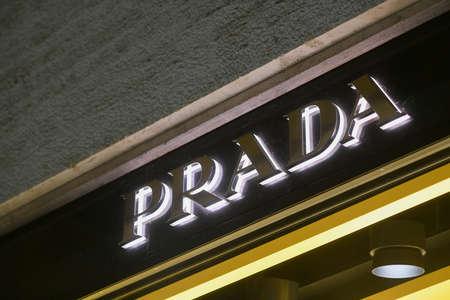 Milan, Italy - January 13, 2020: Lighted Prada store logo