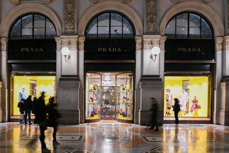 Milan, Italy - January 13, 2020: People in front of Galleria Vittorio Emanuele II Prada showcases at night