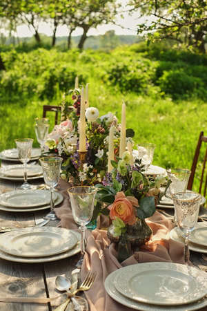 decor wedding dinner in nature in the garden