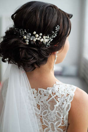 close-up of hair clip on bride's hair Stock Photo