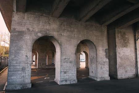 Asphalt parking under the bridge in the evening