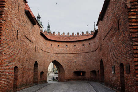 View of the Barbikan gate situated in the Polish city warsaw.