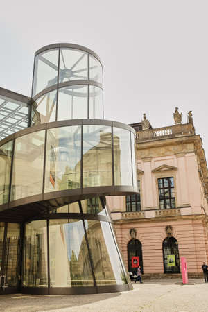 Berlin, Germany - June 27, 2017: German Historical Museum in Berlin. Curve glass reflected old building