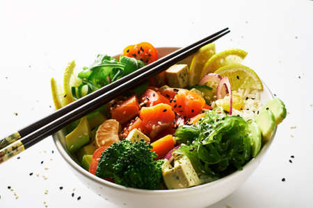 poke bowl with salmon islated on white background. side view 免版税图像