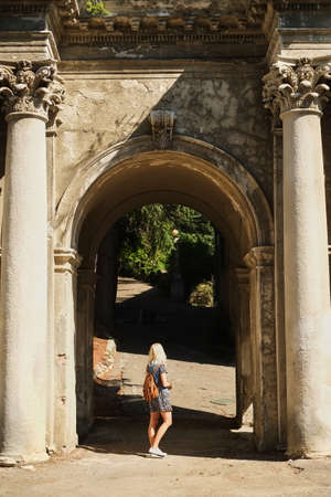 the girl model poses in an arch of the ancient building Reklamní fotografie