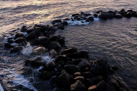 Sunset Seascape. Beautiful sunset with natural coastal cliffs. Stock fotó