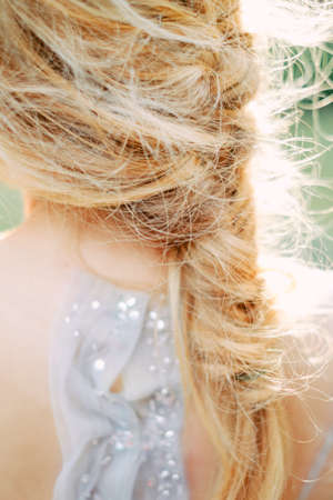 Beautiful bride careless hairstyle. Portrait of young gorgeous bride. Wedding.