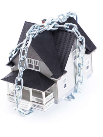 Real estate concept - chain around the house architectural model, isolated Stock Photo - 13648232