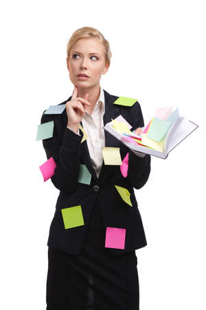 remember: Business woman holding diary and thinking with a sticky notes on her suite
