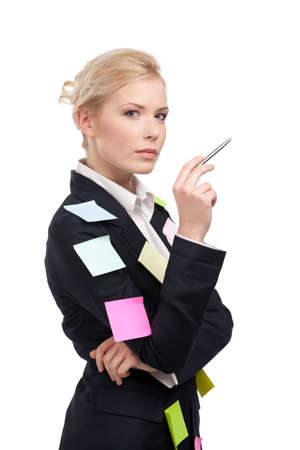 Young business woman in a black suit holding pen, isolated on white background photo