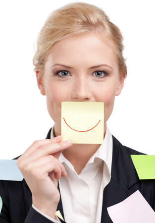 reminder concept: Businesswoman holding a yellow sticker in front of her face, isolated on white background