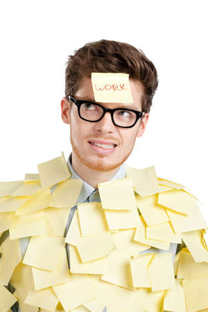 glum: Young man with a sticky note on his face, covered with yellow stickers, isolated on white