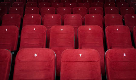 seating: Empty cinema hall with red seats