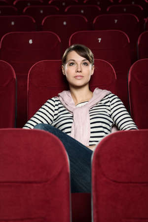 Attractive girl watching  movies alone photo
