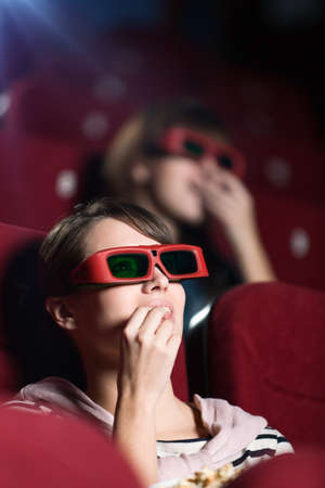 Young woman in 3D movie with popcorn Stock Photo - 13703306