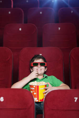 Smiling boy watching 3D movie at the cinema Stock Photo - 13703299